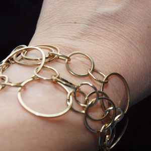 Jewelry - 3/$30!! Gold bracelet with numerous rings
